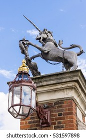 Unicorn Statue in Front of a Palace. The unicorn is part of the Royal arms of Queen Elizabeth II. They are on display in around most British royal palaces.
