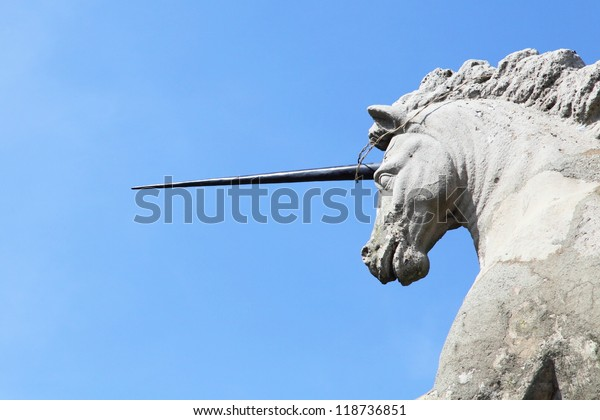 unicorn statue juxtaposed aganist blue sky at Borromeo Palace garden of Lake Maggiore, Italy