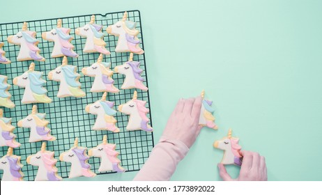 Unicorn sugar cookies decorated with royal icing and food glitter.