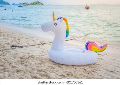 Unicorn swim tube on the beach Inflatable unicorn. Fantasy Swim Ring for Summer Pool Trip