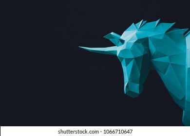 Unicorn turquoise head paper isolated on black background. Copy space.