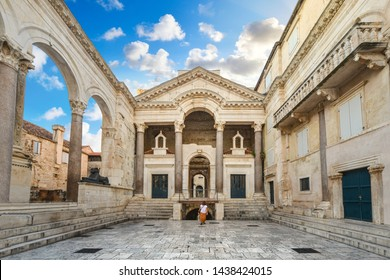A unidentifiable Croatian woman walks through the Peristil or Peristyle Square of the ancient Diocletian's Palace in the old town area of Split, Croatia early in the morning.
