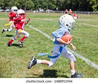 Unidentifiable kids playing flag American football