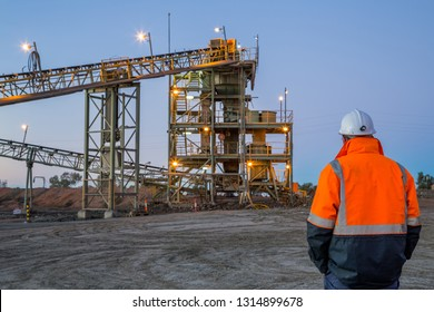 Unidentifiable miner in front of a copper mine head in NSW Australia