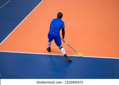Unidentifiable player playing floorball