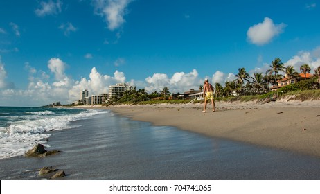 Unidentifiable senior man briskly walking on beautiful beach in Jupiter Hobe Sound area of Florida
