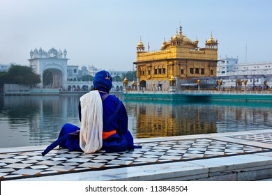 Unidentifiable Sikh Nihang warrior meditating at Seekh temple Golden Temple (Harmandir Sahib). Amritsar, India