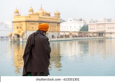 Unidentifiable Sikh Nihang warrior meditating at Seekh temple Golden Temple (Harmandir Sahib). Amritsar, India