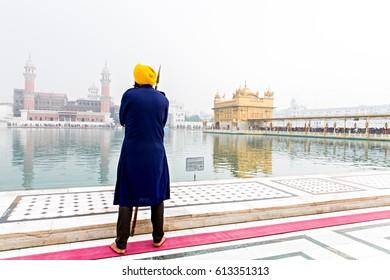 Unidentifiable Sikh warrior on guard at Seekh temple Golden Temple (Harmandir Sahib). Amritsar, India