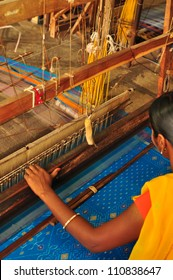 Unidentifiable textile worker weaving Ikkat saree at India