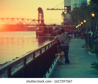 Unidentifiable young couple take selfie in New York by the river