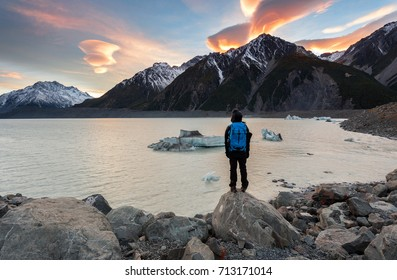 Unidentified adventurer enjoying scenic view at Mount Cook National Park, South Island, New Zealand