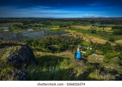 Unidentified adventurer posed with rice field in Sumba Island, Indonesia