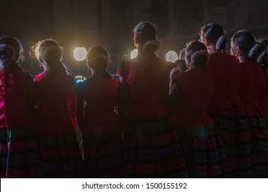 unidentified artists singing carnatic music songs on stage and this was photographed from back stage and lights add beauty to the scene, its one of the famous cultural event. chennai india tamil nadu