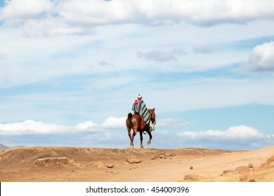 Unidentified Basotho man  on a horse wearing traditional blanket in the Mountains of Lesotho