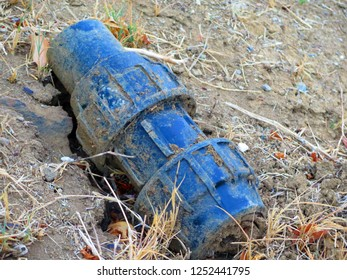 Unidentified blue metal object half buried in Andalusian countryside