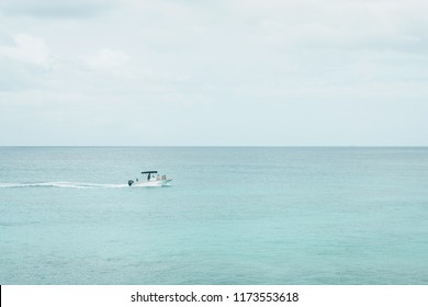Unidentified boat in the turquoise water of  Carlisle Bay, Bridgetown, Barbados.