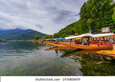unidentified boats are parked for tourists near  Dal Lake, Jammu and Kashmir, India on June 22, 2018 for tourists