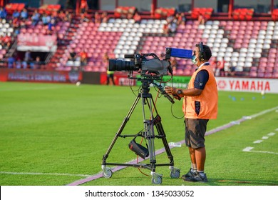 Unidentified camera-man in action during The Football Thai League match between SCG Muangthong United and PT Prachuap F.C.at SCG Stadium on February24,2019 in Nonthaburi,Thailand