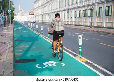 Unidentified cyclist riding on Bangkok's bike lane