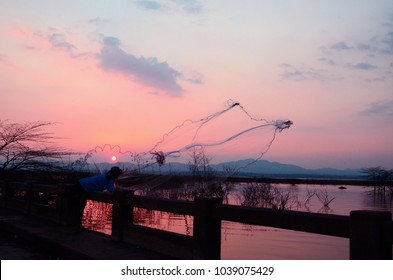 Unidentified fisherman with traditional fishing and throw the fishnet at Tha Ngoi, Pakchong, Nakhonratchsrima province, Thailand. (March 04, 2017)