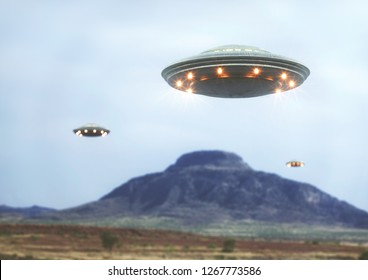 Unidentified flying object over the desert with a mountain behind.