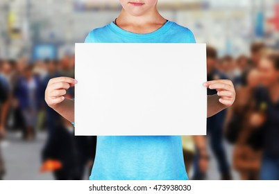 Unidentified girl holds a blank sheet of paper