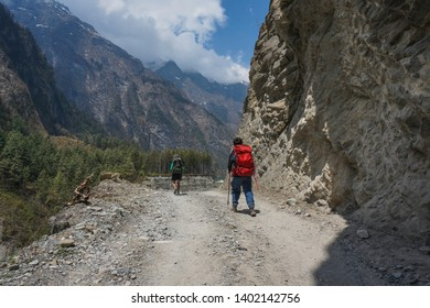 Unidentified hikers are seen hiking from Chame to Pisang in Annapurna Circuit
