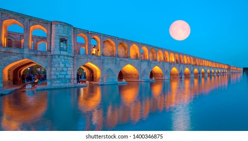 Unidentified Iranian family resting in the ancient Khaju Bridge, (Pol-e Khaju) -Isfahan, Iran