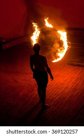 An unidentified Kalaripayattu master before jumping through fire ring during Kalaripayattu martial arts demonstration in Kerala, India.