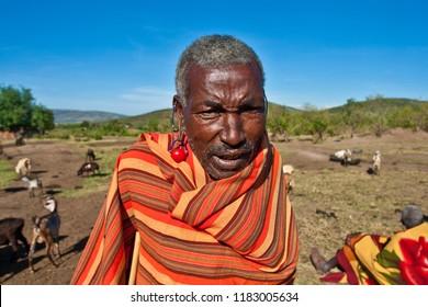 Unidentified Maasai man on Oct 15, 2012 in the Maasai Mara, Kenya. Maasai are a Nilotic ethnic group of semi-nomadic people located in Kenya and northern Tanzania.