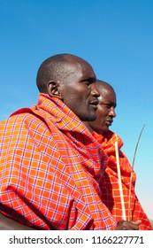 Unidentified Maasai men on Oct 15, 2012 in the Maasai Mara, Kenya. Maasai are a Nilotic ethnic group of semi-nomadic people located in Kenya and northern Tanzania.
