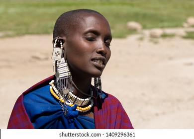Unidentified Maasai woman at the entrance of the Serengeti National Park in Tanzania, circa March 2010. Maasai are a Nilotic ethnic group of semi-nomadic people located in Kenya and northern Tanzania.