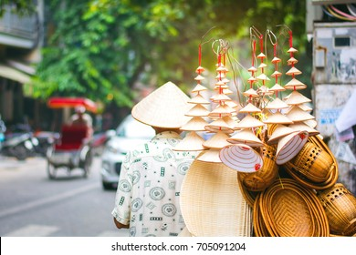 Unidentified man drives motorcycle with baskets in Hanoi, Vietnam. Street vending by bike is an essential part of life in Vietnam.
