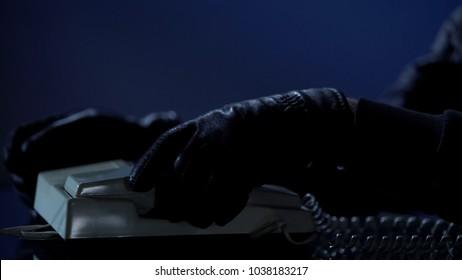 Unidentified man puts handset after calling to blackmail victim, demands money