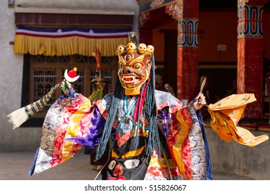 Unidentified monk in mask performs a religious masked and costumed mystery dance of Tibetan Buddhism during the Cham Dance Festival in Lamayuru monastery, Ladakh, India.