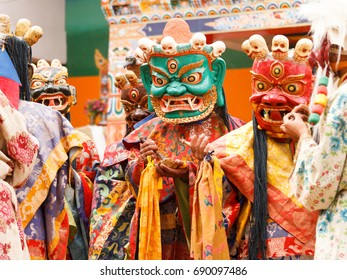 Unidentified monks in masks perform a religious masked and costumed mystery dance of Tibetan Buddhism during the Cham Dance Festival in Lamayuru monastery, India.