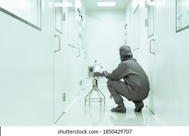 Unidentified operator is setting the instrument for airborne particle counter in the cleanroom, concept of cleanliness, environment and particle contamination in HVAC system.