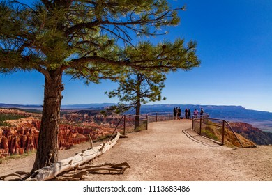 Unidentified people looking at Bryce Canyon from inspiration point