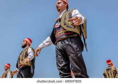Unidentified people perform a traditional folklore dance with their ethnic clothes.ISTANBUL, TURKEY, May 13, 2017