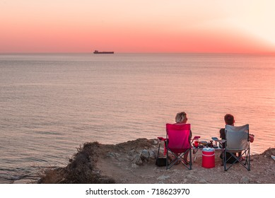Unidentified people wait for sunset at Bozcaada,Turkey:21 August,2017
