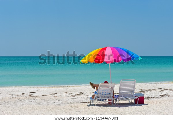unidentified-person-relaxing-under-color