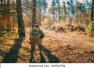 Unidentified Re-enactor Dressed As Soldier Of United States Of America Infantry Of World War II Hidden Running With Sub-machine Gun In Forest At Historical Reenactment