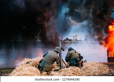 Unidentified Re-enactors Dressed As World War II German Soldiers Fired From A Mortar. Re-enactment Of Battle Of Great Patriotic War In Belarus.