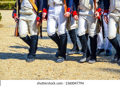 unidentified reenactors marching in early 19th century uniform during an event relative to the napoleonic wars