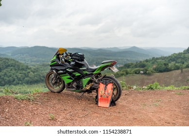 Unidentified rider with motorcycle Kawasaki ninja 300 at Nan province, Thailand. 10 August 2018