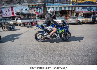Unidentified rider with motorcycle in rider meeting at Chiangrai, Thailand 31 December 2016
