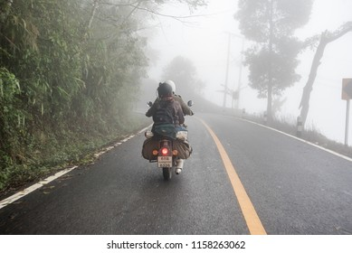 Unidentified rider with motorcycle royal enfield classic 500 at Nan province, Thailand. 10 August 2018