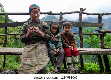 Unidentified Sherpa children with their mother in Lukla, Everest region, Nepal, circa October 2006
