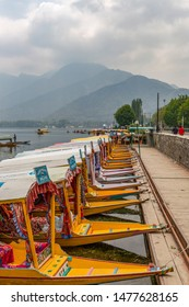 unidentified shikaras or boats are parked in dal lake for tourists in jammu and kashmir, india on june 23, 2018